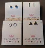 Zilver-, goud- en zwartkleurige geometrische oorstekers_